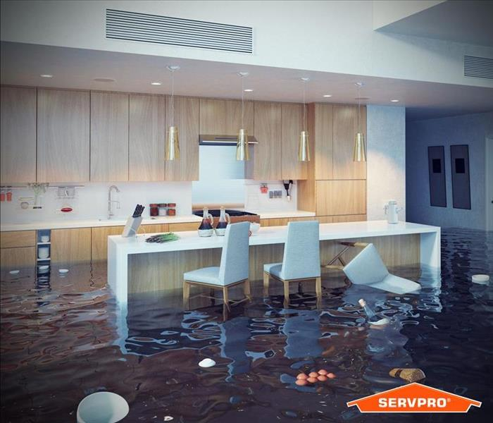 a flooded kitchen in a home with floating debris in the water